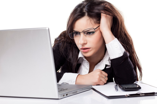 confused woman using laptop