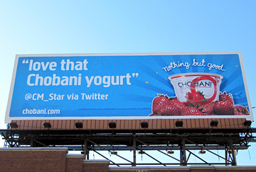 A Chobani yogurt billboard featuring a tweet from a customer.
